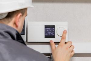 Adjusting Thermostat for Automated Heating - Heating Service Scottsdale AZ