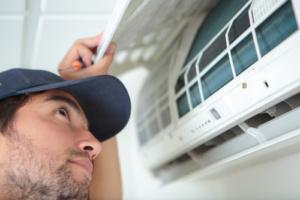 Man Inspecting Air Conditioner Mesa AZ