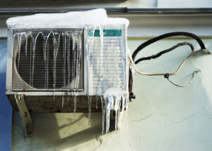 Are you supposed to cover your AC unit in winter?